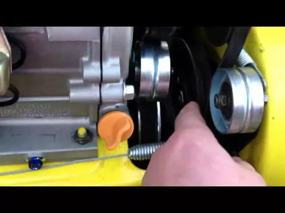 Регулировка ролика натяжения ремня шнека снегоуборщика